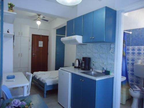 A kitchen or kitchenette at Kallithea Studios