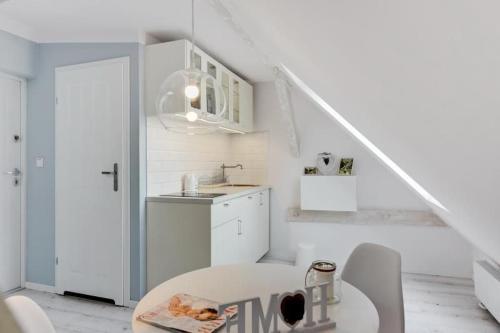Kuchnia lub aneks kuchenny w obiekcie Apartments Kosciuszki 44