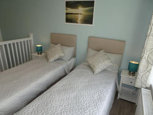 A bed or beds in a room at The Whiteways