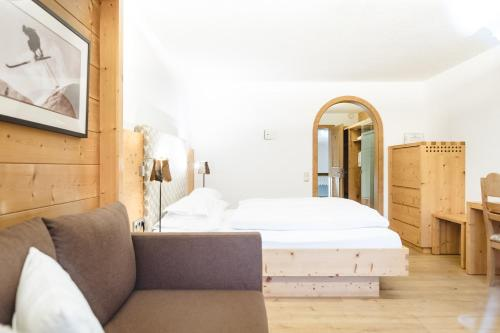 A bed or beds in a room at Aktiv & Spa Hotel Alpenrose