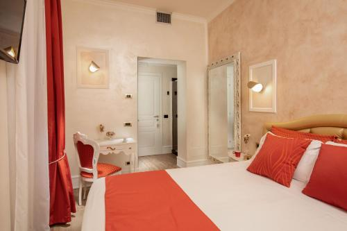 A bed or beds in a room at I Fiumi Di Navona