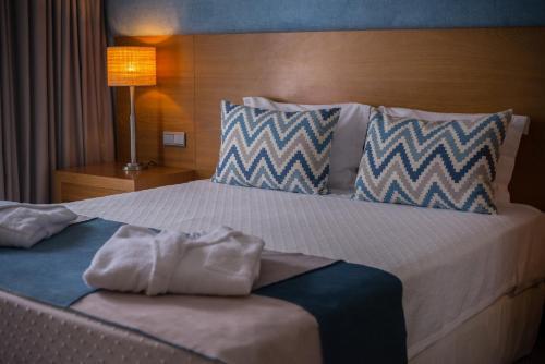 Uma cama ou camas num quarto em Hotel Do Caracol