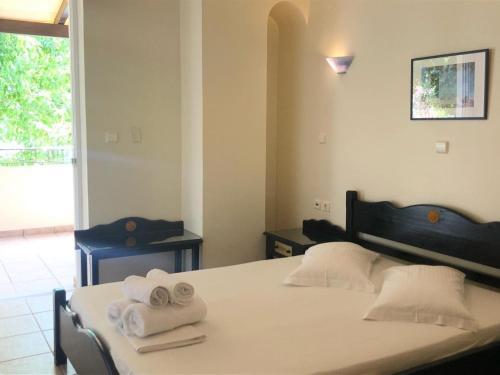 Ένα ή περισσότερα κρεβάτια σε δωμάτιο στο Sun Rise Hotel Apartments