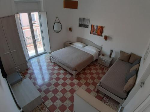A bed or beds in a room at Amam B&B