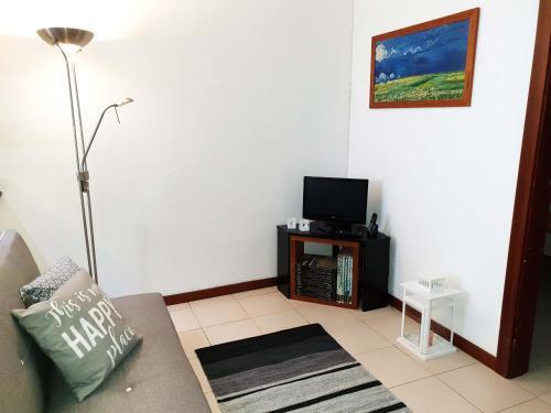Uma televisão e/ou sistema de entretenimento em Casa da Travessa