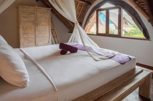 A bed or beds in a room at United Colors of Bali