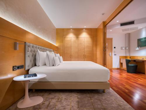 Cama o camas de una habitación en Sansi Pedralbes