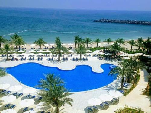 A view of the pool at Al Bahar Hotel & Resort or nearby