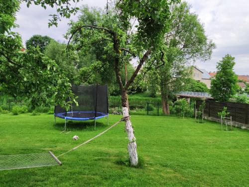 A garden outside 9 min from Palanga! Cosy River Side Studio with sauna