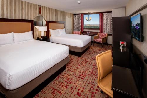 A bed or beds in a room at Nugget Casino Resort