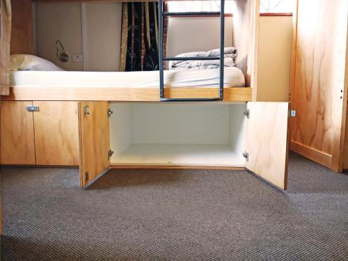 A bunk bed or bunk beds in a room at The Flaming Kiwi Backpackers