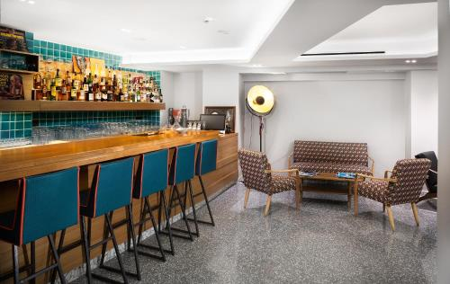 The lounge or bar area at 360Degrees Pop Art Hotel