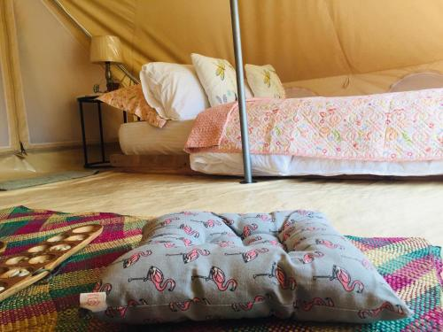 A bed or beds in a room at Balili Eco Glamping Port Barton