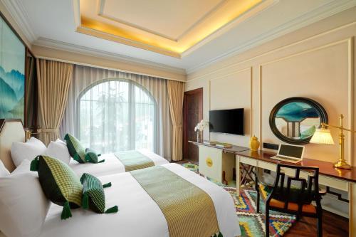 A television and/or entertainment center at Silk Path Grand Resort & Spa Sapa