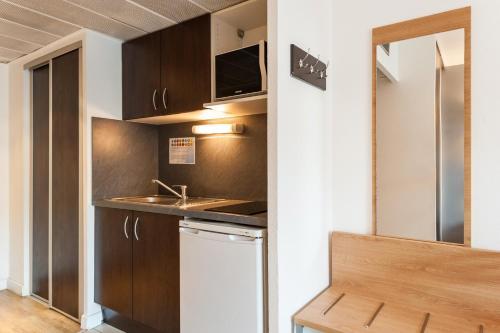 A kitchen or kitchenette at Residhotel Le Grand Prado