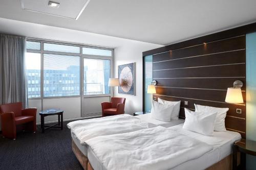 Letto o letti in una camera di Imperial Hotel