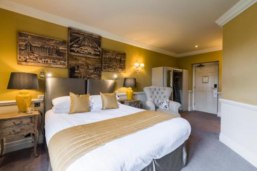 A bed or beds in a room at Coombe Abbey Hotel