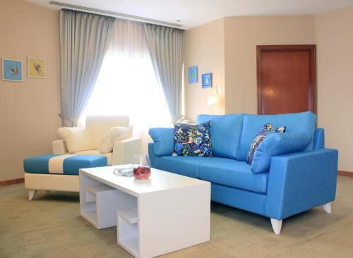 A seating area at Alocassia Serviced Apartments (SG Clean)