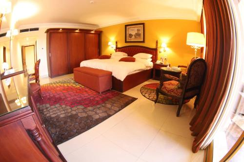 A bed or beds in a room at PortSaid Hotel