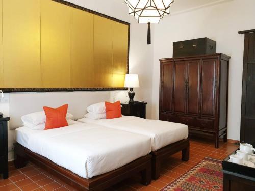 Un ou plusieurs lits dans un hébergement de l'établissement Rachamankha Hotel a Member of Relais & Châteaux