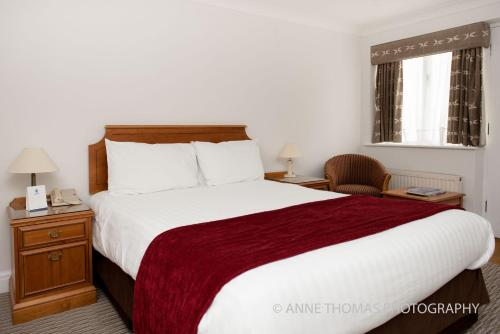 A bed or beds in a room at Best Western Priory Hotel