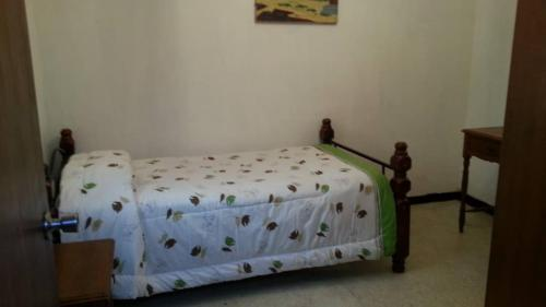 A bed or beds in a room at Candida