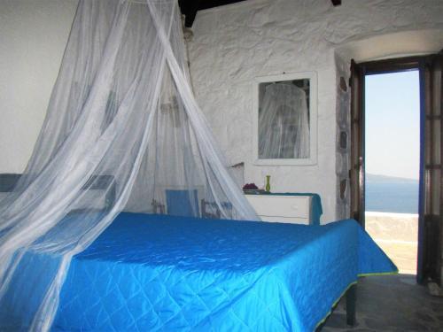 Ένα ή περισσότερα κρεβάτια σε δωμάτιο στο Blue Horizon House