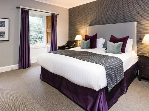 A bed or beds in a room at Craigatin House & Courtyard