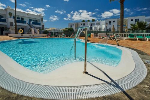 Het zwembad bij of vlak bij Hotel Suite Montana Club