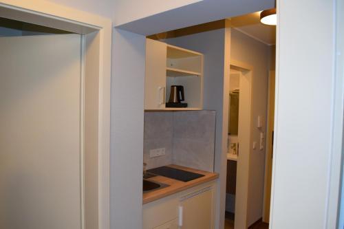 A kitchen or kitchenette at Trip Inn Residence City Center