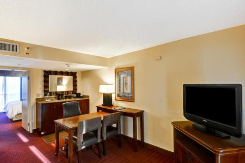 A television and/or entertainment center at Embassy Suites Orlando - North