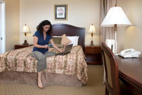 Säng eller sängar i ett rum på Hotel Beresford