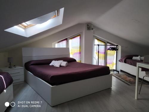 A bed or beds in a room at B&B Residenza Leonardo