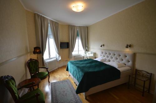 Säng eller sängar i ett rum på Hotell Royal