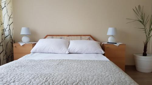 Кровать или кровати в номере Hotel Śnieżnik