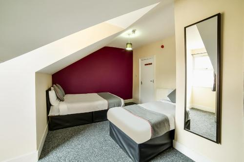 A bed or beds in a room at Stratford Hotel