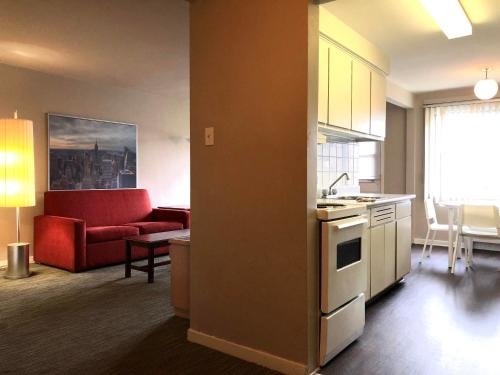 A kitchen or kitchenette at Beausejour Hotel Apartments/Hotel Dorval