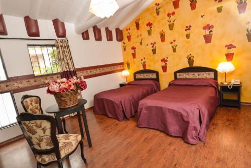 Ein Bett oder Betten in einem Zimmer der Unterkunft Tika Wasi Casa Boutique