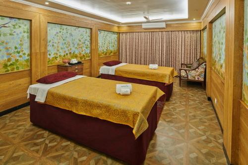 A bed or beds in a room at MAYFAIR Himalayan Spa Resort