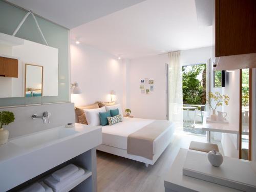 A bathroom at Kouros Seasight Hotel