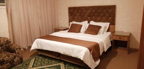 Cama ou camas em um quarto em Dar Al Riyadh Apartments