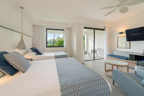 A bed or beds in a room at Catalonia Punta Cana - All Inclusive