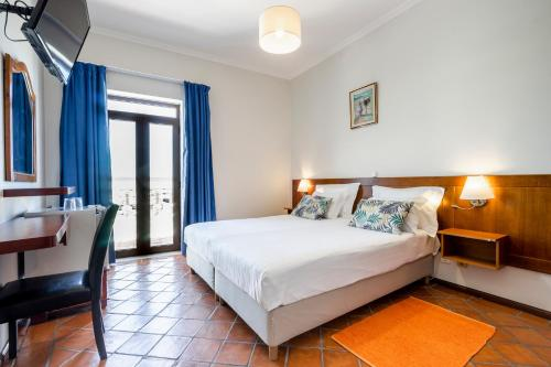 A bed or beds in a room at Residencial Mares
