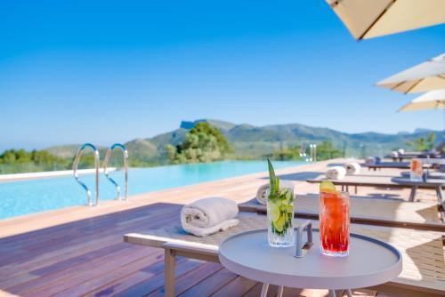 Poolen vid eller i närheten av Carrossa Hotel Spa Villas