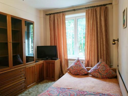 Кровать или кровати в номере Apartment on Khoroshevskiy proyezd