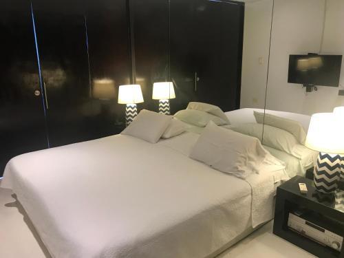 A bed or beds in a room at Apartamento Con Vista Al Caribe