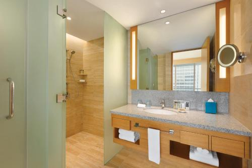 A bathroom at JEN Singapore Orchardgateway by Shangri-La - SGClean