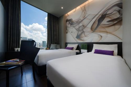 A bed or beds in a room at V Hotel Lavender - SG Clean