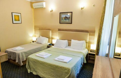 Кровать или кровати в номере Hotel Old Town