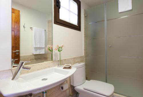 A bathroom at Hotel Suite Villa Maria
